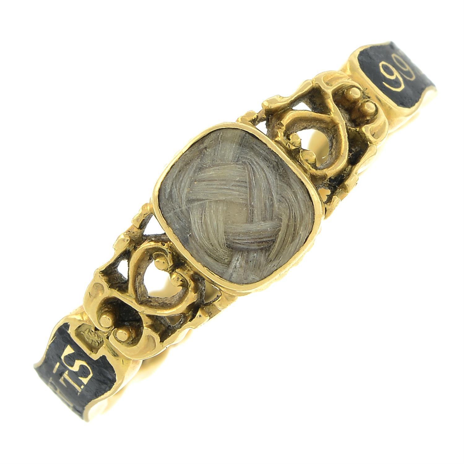 An early Victorian 18ct gold black enamel mourning ring, with pierced scrolling sides and woven - Image 2 of 7