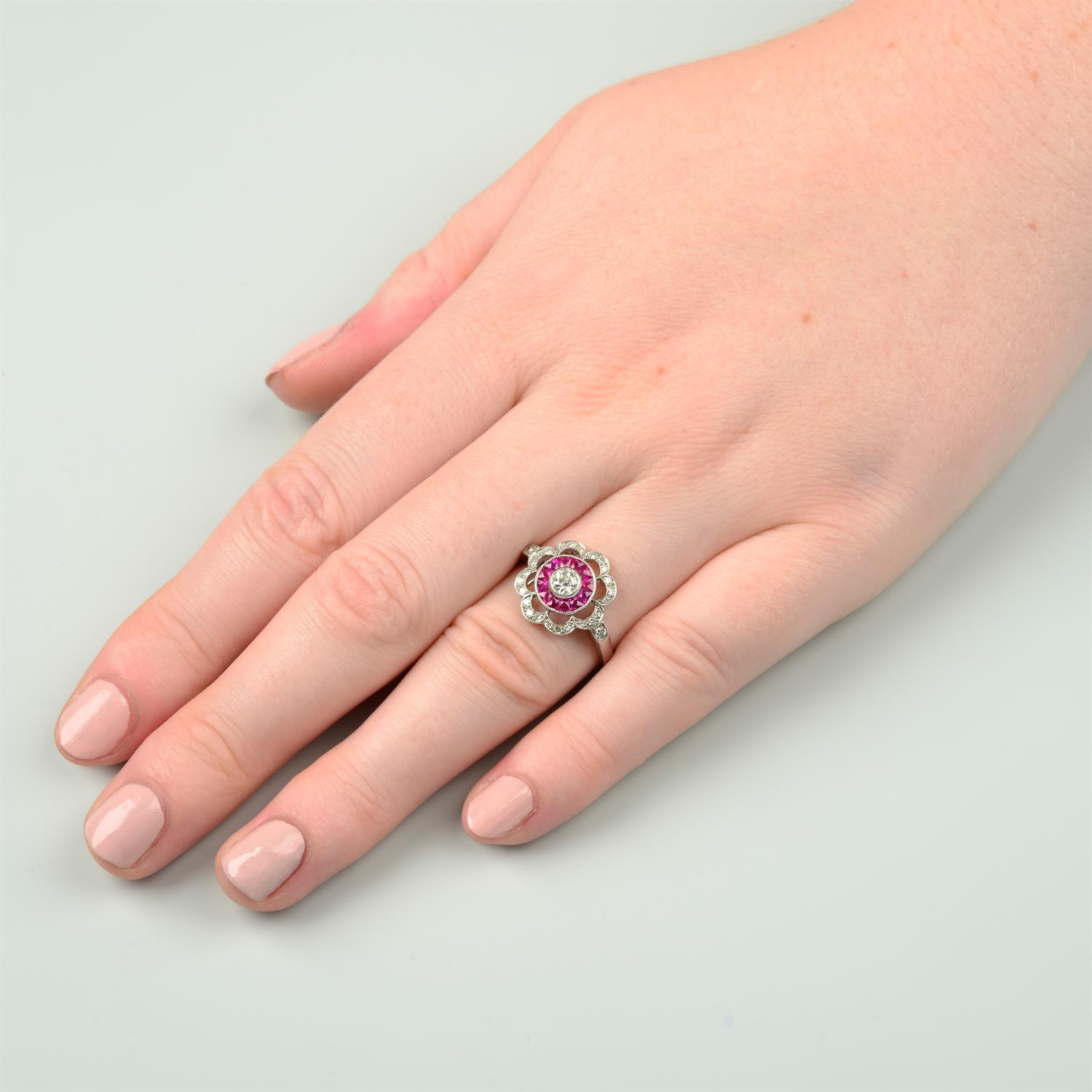 An 18ct gold diamond and French-cut ruby floral cluster ring. - Image 6 of 6
