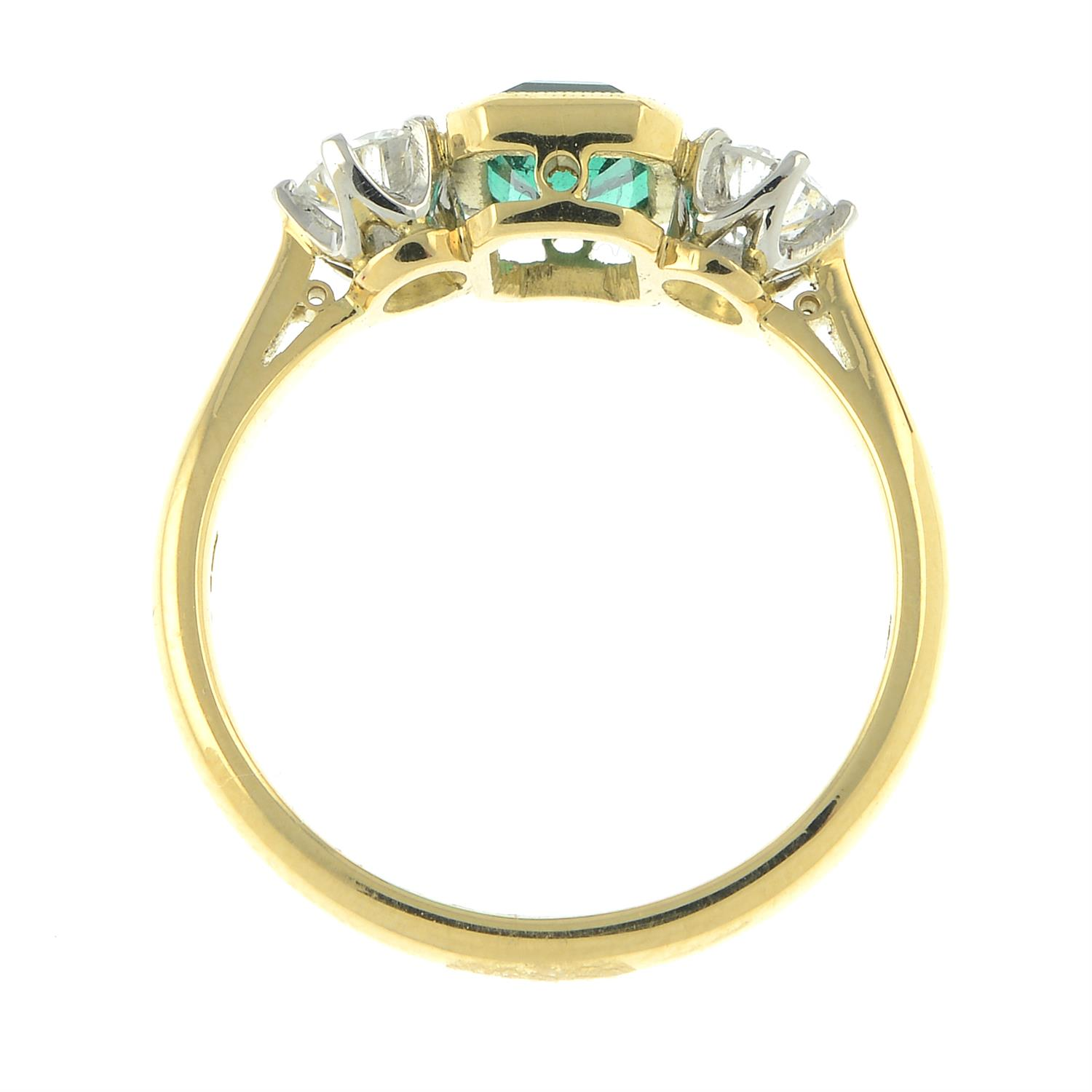 A platinum and 18ct gold emerald and brilliant-cut diamond three-stone ring. - Image 5 of 6