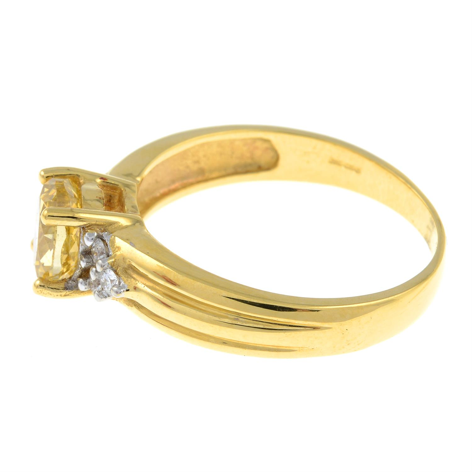 An 18ct gold oval-shape 'brownish-yellow' diamond ring, with brilliant-cut diamond trefoil sides. - Image 3 of 6