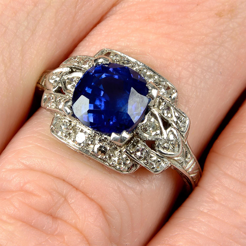 A sapphire and single-cut diamond dress ring.