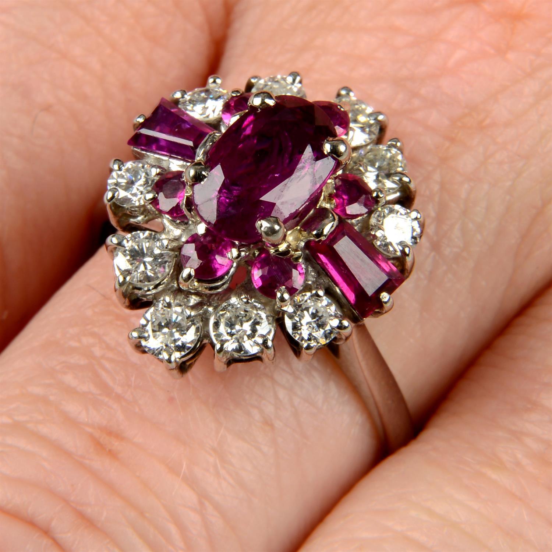 A vari-cut ruby and brilliant-cut diamond dress ring.