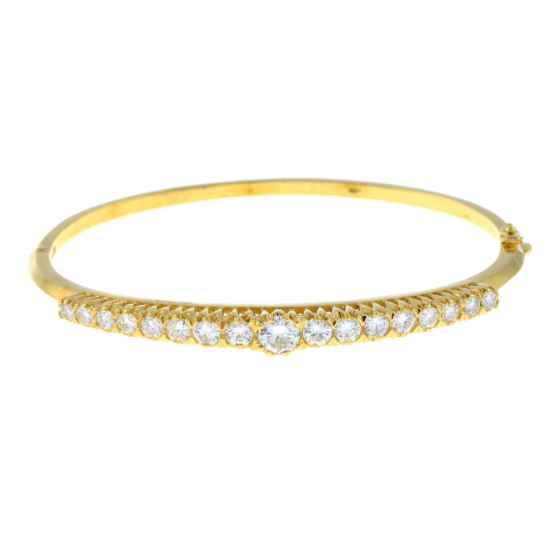 A graduated brilliant-cut diamond hinged bangle. - Image 2 of 4