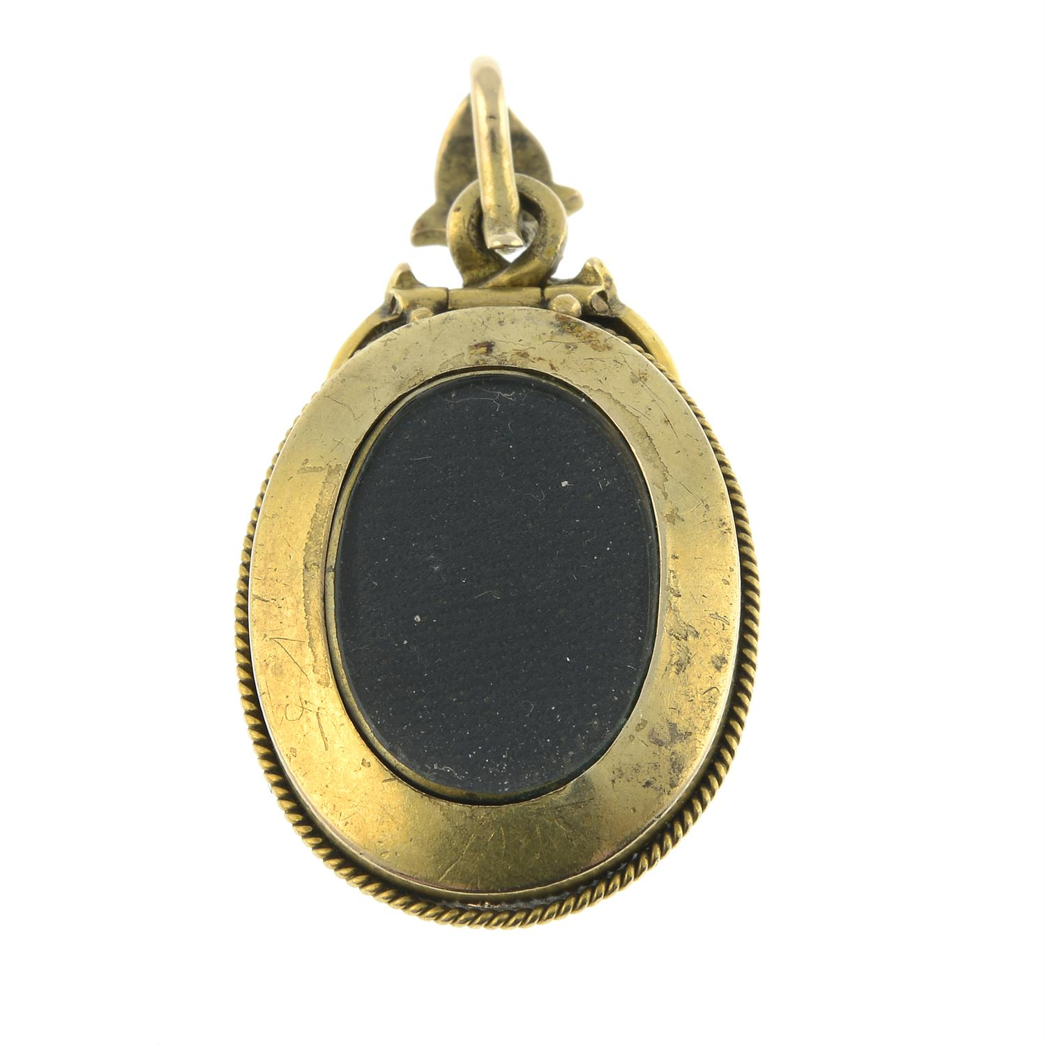 A late Victorian gold foil back garnet and split pearl pendant, with locket reverse. - Image 3 of 4