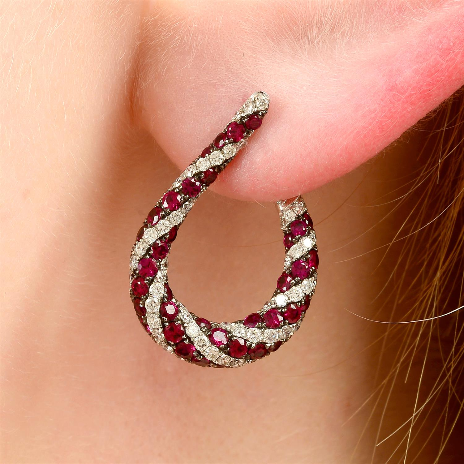 A pair of 18ct gold brilliant-cut diamond and ruby spiral hoop earrings.