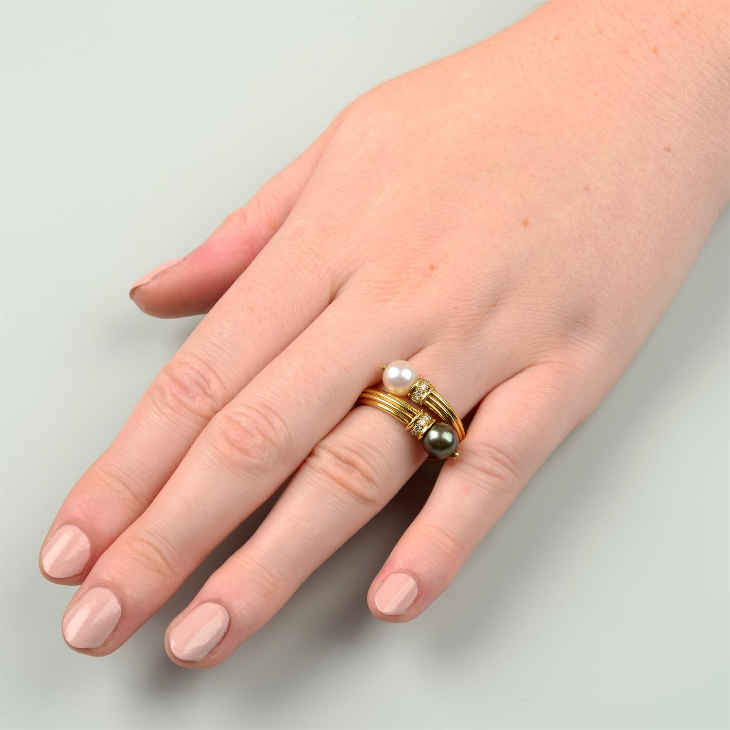 An 18ct gold grooved ring, with vari-hue cultured pearl and brilliant-cut diamond crossover - Image 5 of 5