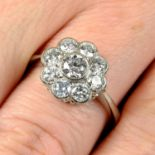 A brilliant-cut diamond floral cluster ring.