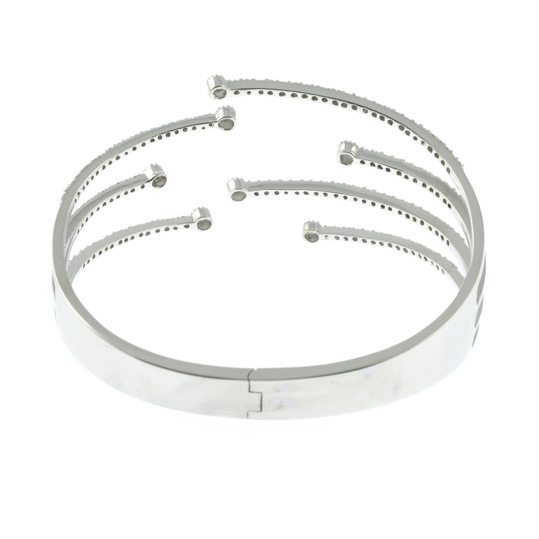 A brilliant-cut diamond open hinged bangle. - Image 4 of 5