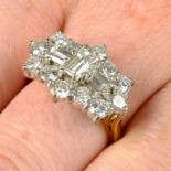 An 18ct gold baguette and brilliant-cut diamond cluster ring.