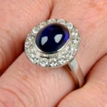 An 18ct gold sapphire cabochon and brilliant-cut diamond ring.