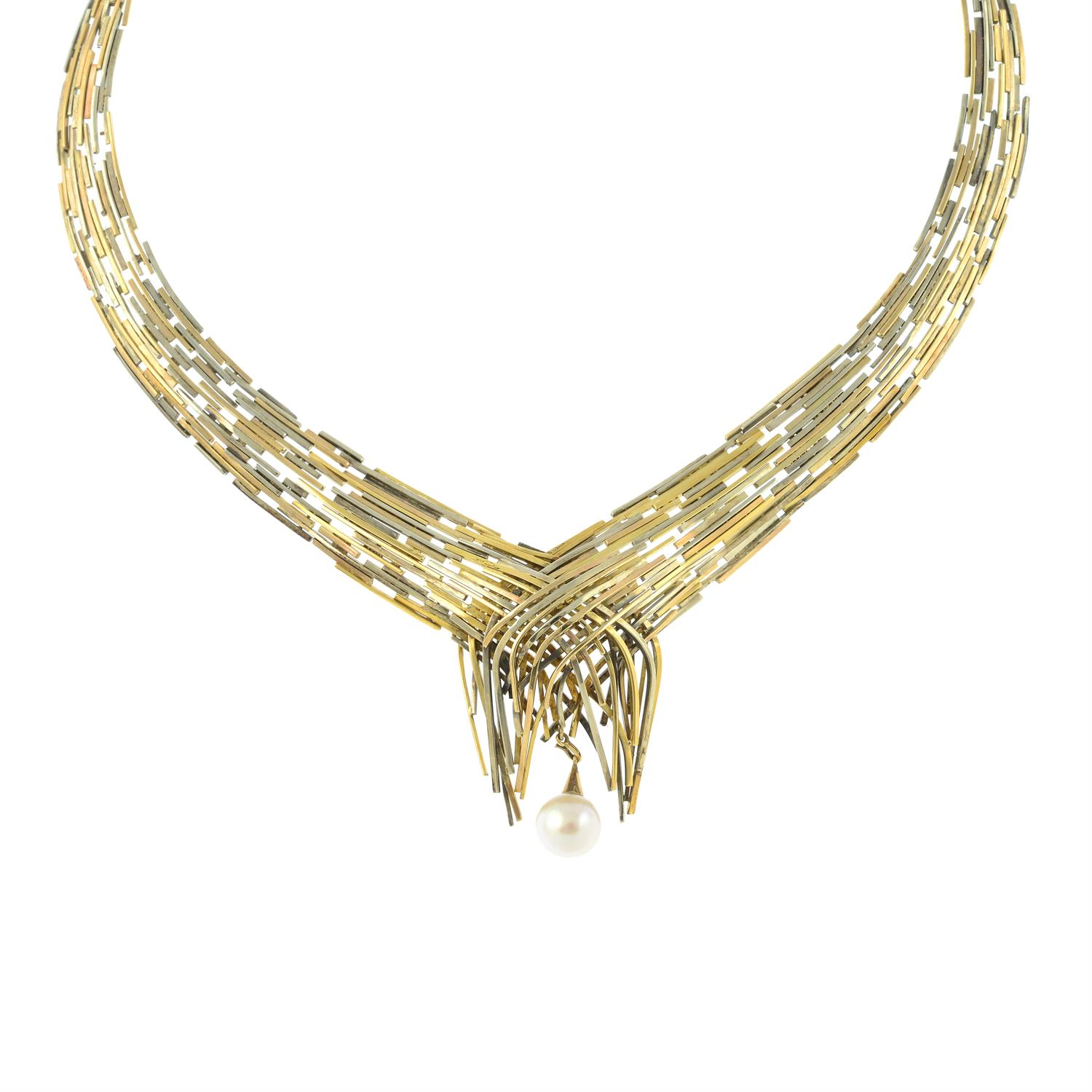 A 1960s tri-colour 9ct gold 'Boyd' articulated collar necklace, with interchangeable green - Image 2 of 7