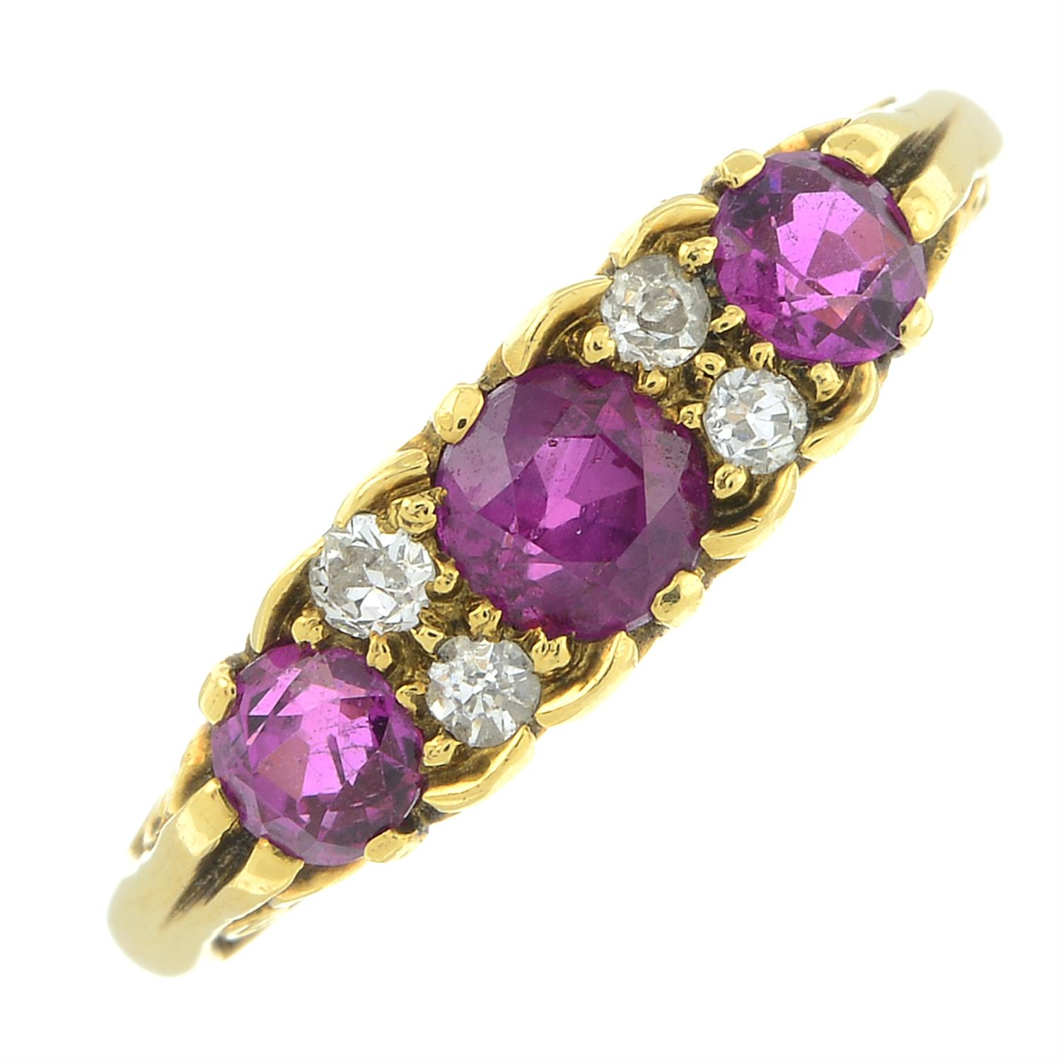 An 18ct gold slightly graduated ruby three-stone ring, with diamond double spacers and scrolling - Image 2 of 6