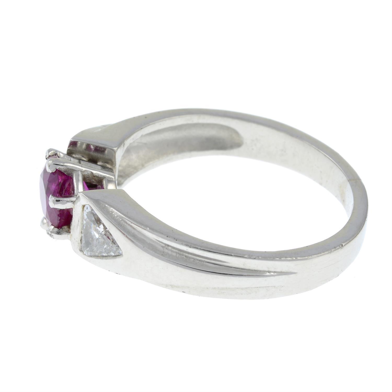A Burma ruby and triangular-shape diamond three-stone ring. - Image 3 of 7