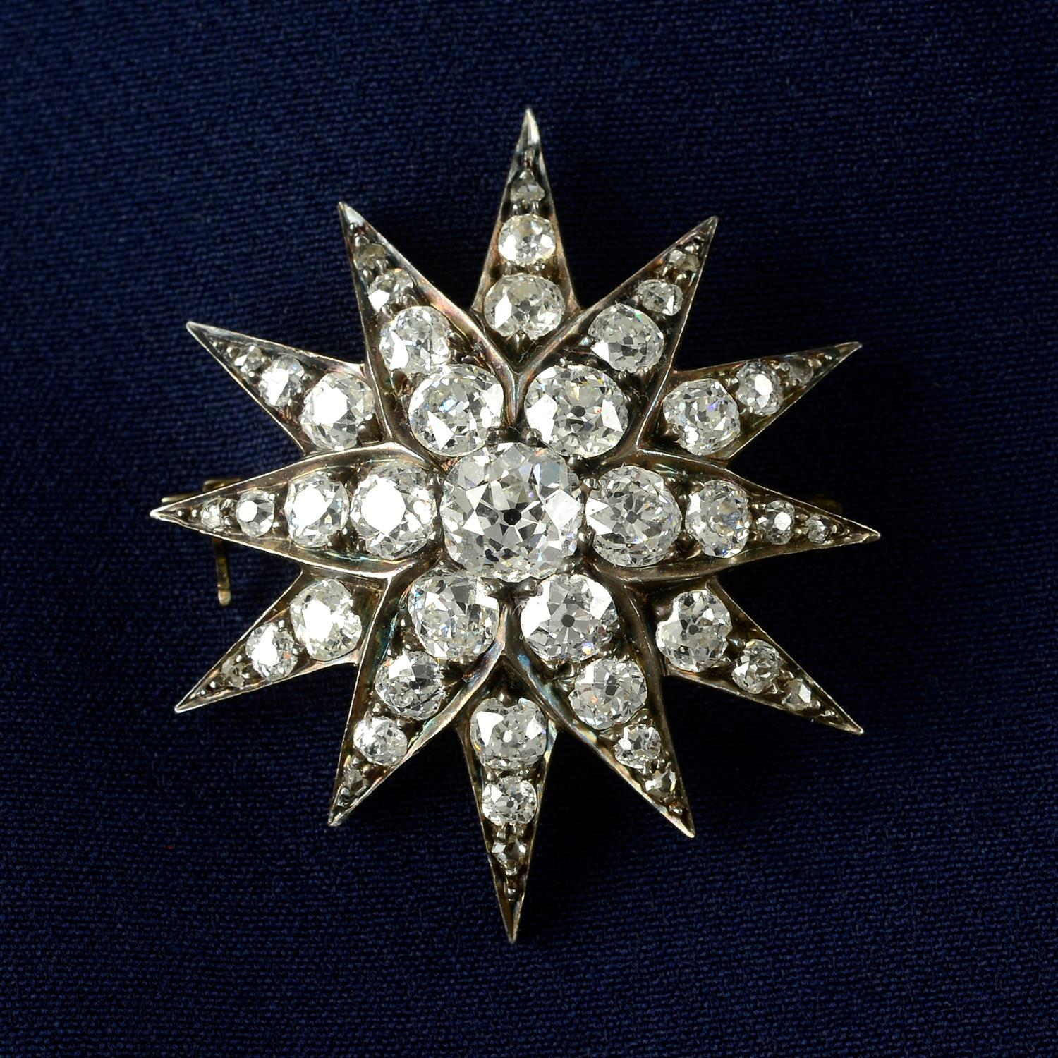 A late Victorian silver and gold, old-cut diamond star brooch.