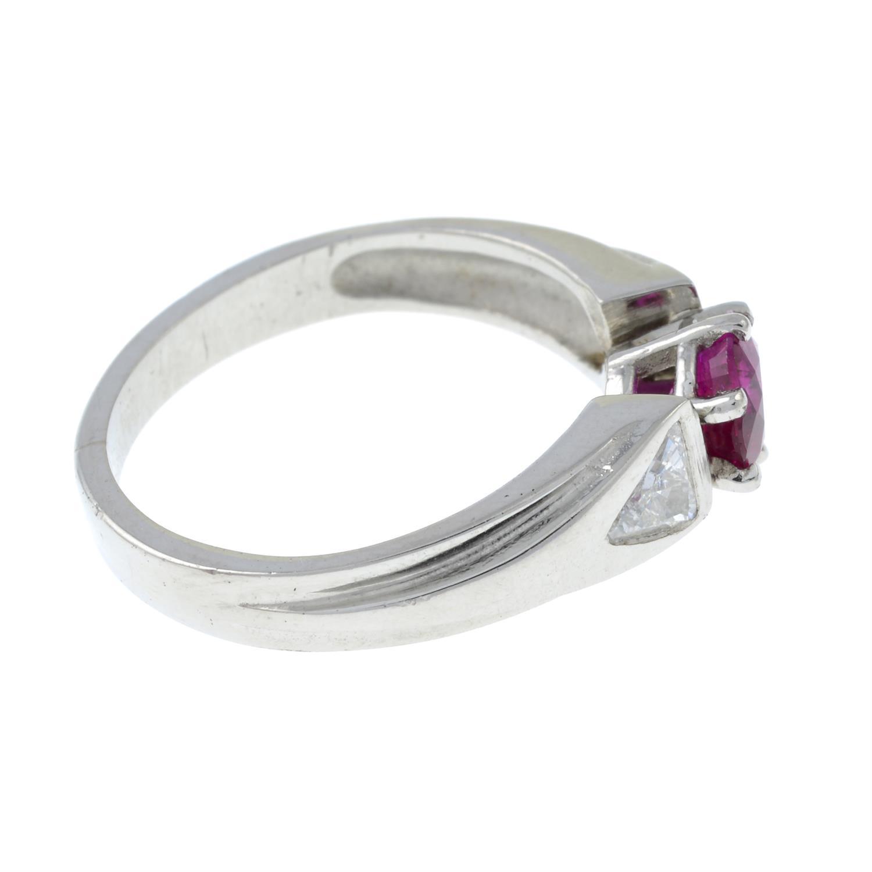 A Burma ruby and triangular-shape diamond three-stone ring. - Image 4 of 7