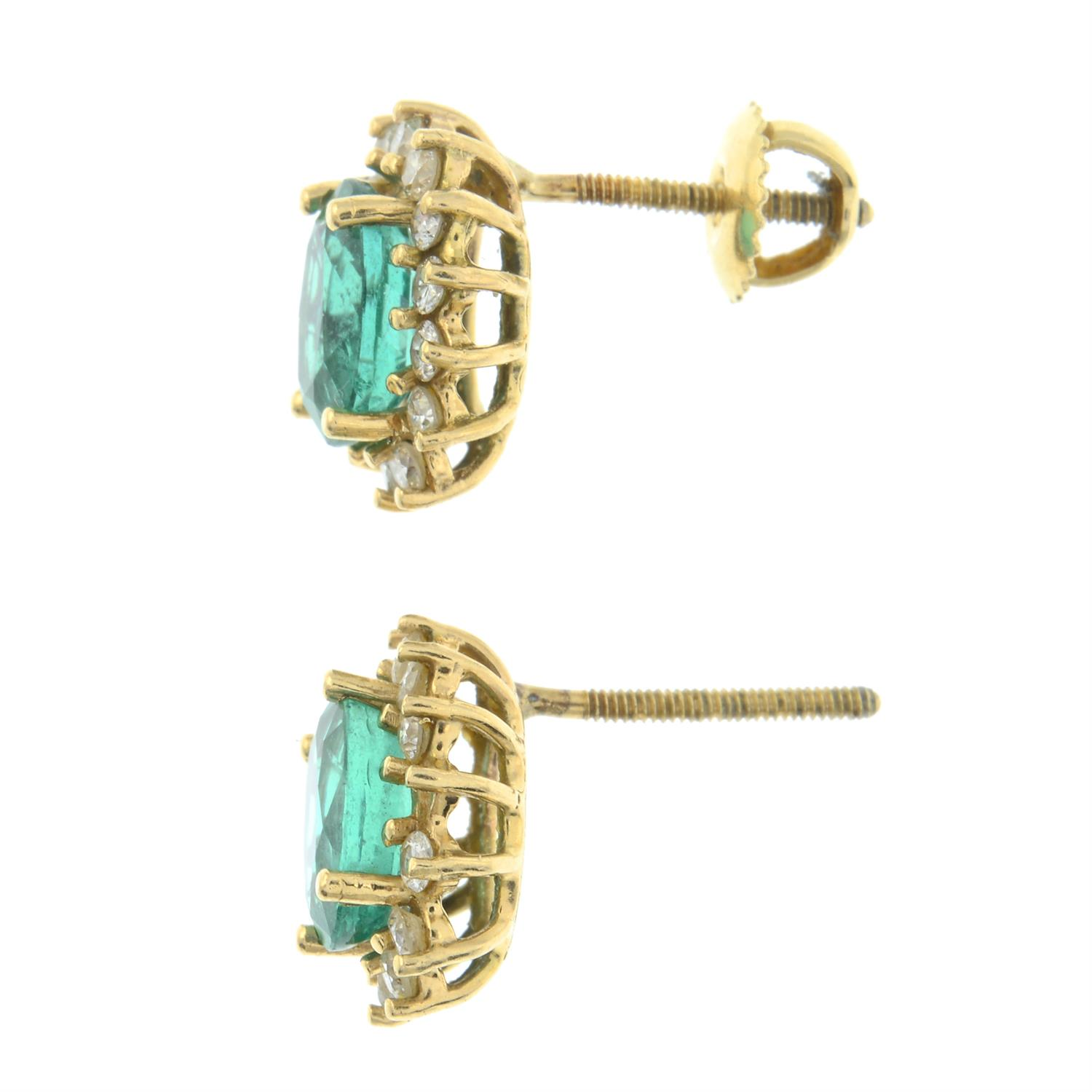 A pair of Zambian emerald and brilliant-cut diamond cluster earrings. - Image 4 of 5