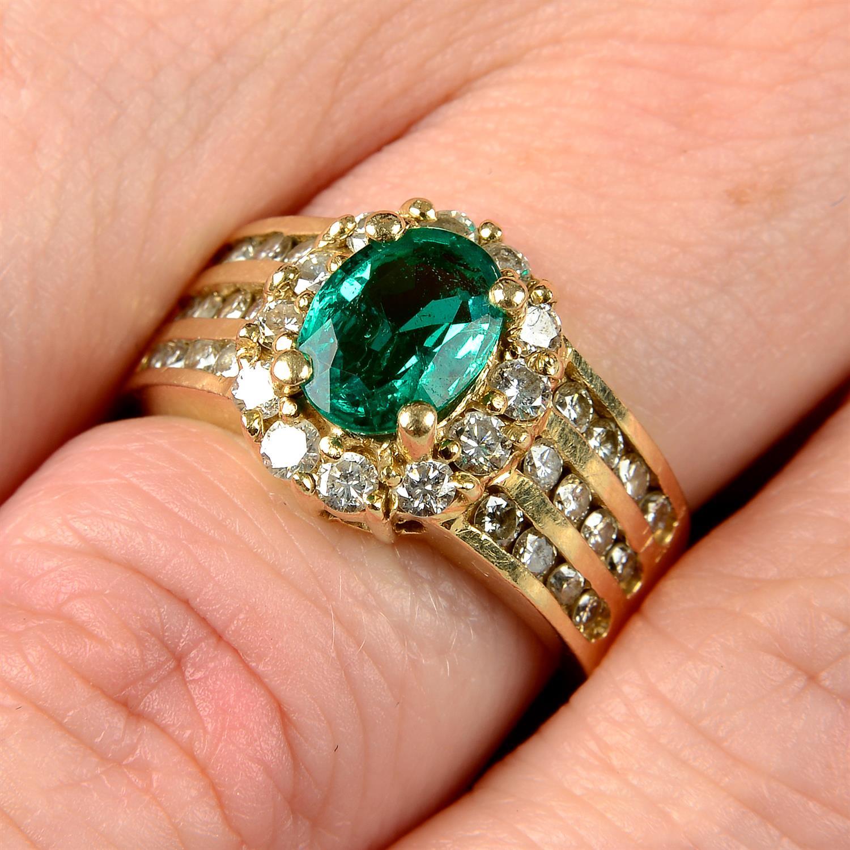 A Zambian emerald and brilliant-cut diamond cluster ring.