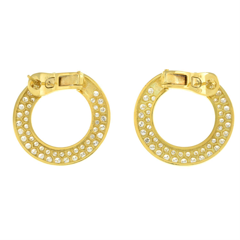 A pair of pavé-set diamond circular earrings. - Image 3 of 3