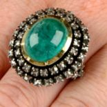 An emerald cabochon and rose-cut diamond cluster ring.