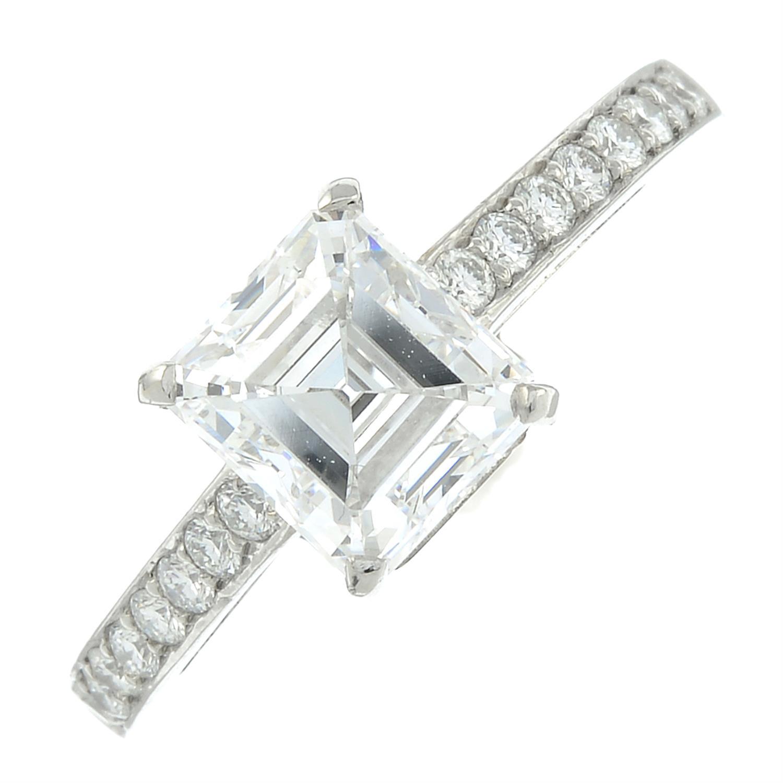 A platinum rectangular-shape diamond single-stone ring, with brilliant-cut diamond line shoulders. - Image 2 of 8