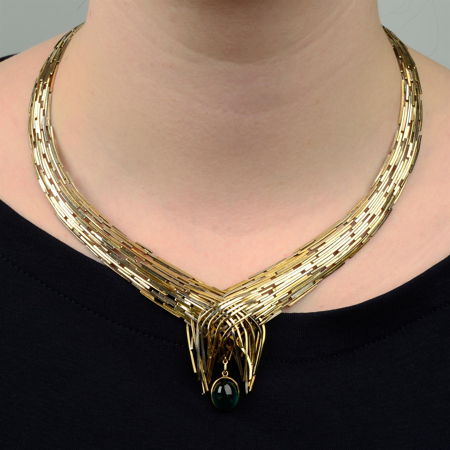 A 1960s tri-colour 9ct gold 'Boyd' articulated collar necklace, with interchangeable green - Image 7 of 7