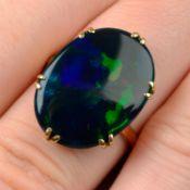 A black opal single-stone ring.