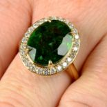 A green tourmaline and brilliant-cut diamond cluster ring.