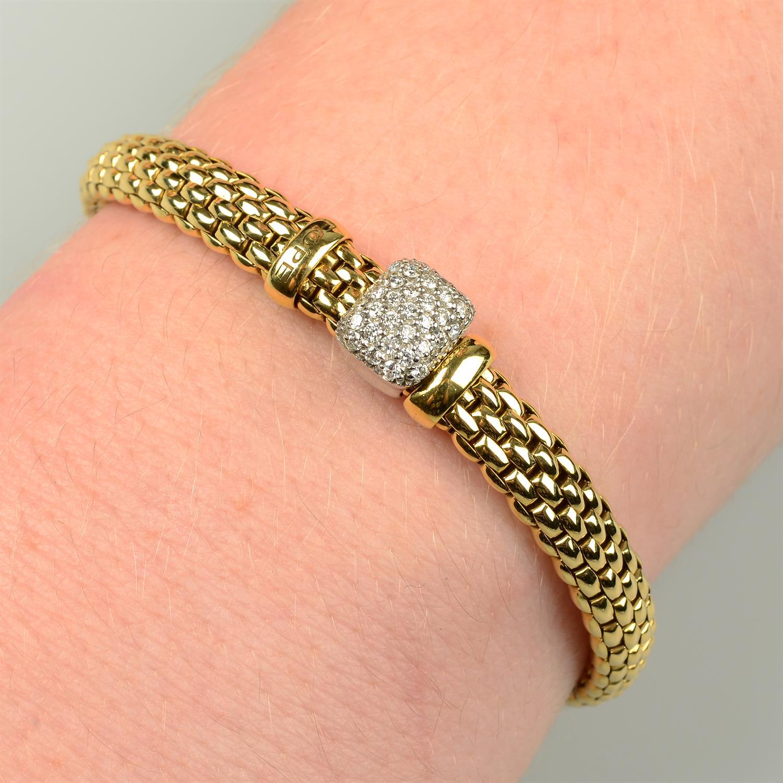 An 18ct gold 'Flexit' bracelet, by Fope, with pavé-set diamond slide.