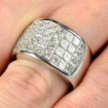 A pavé-set diamond band ring.