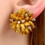 A pair of Italian 1960s 18ct gold diamond, textured floral earrings.
