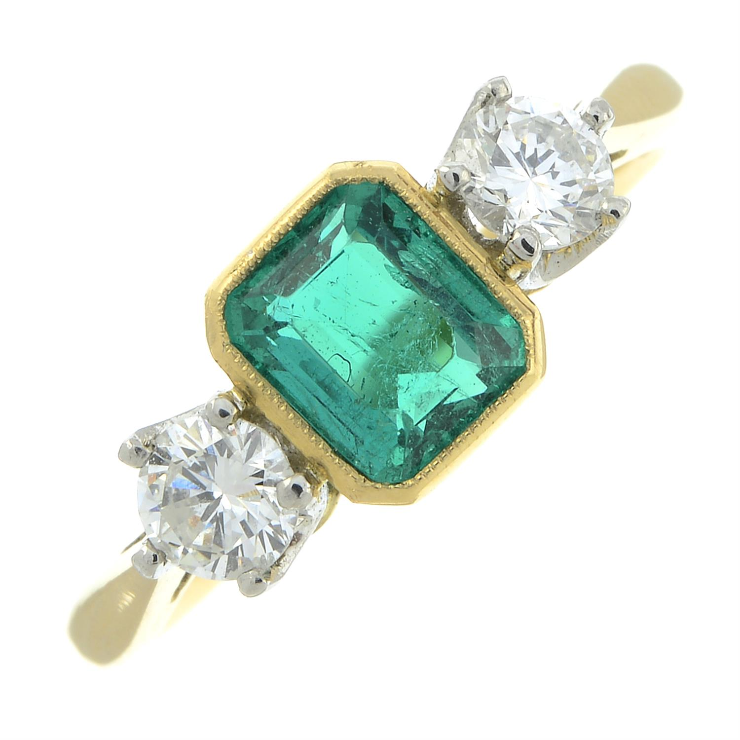 A platinum and 18ct gold emerald and brilliant-cut diamond three-stone ring. - Image 2 of 6