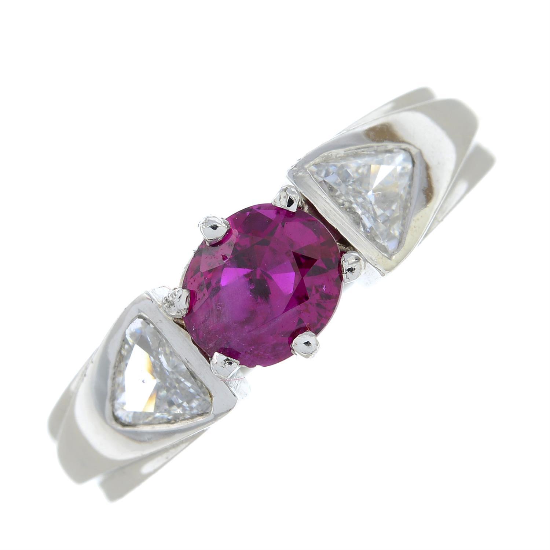 A Burma ruby and triangular-shape diamond three-stone ring. - Image 2 of 7