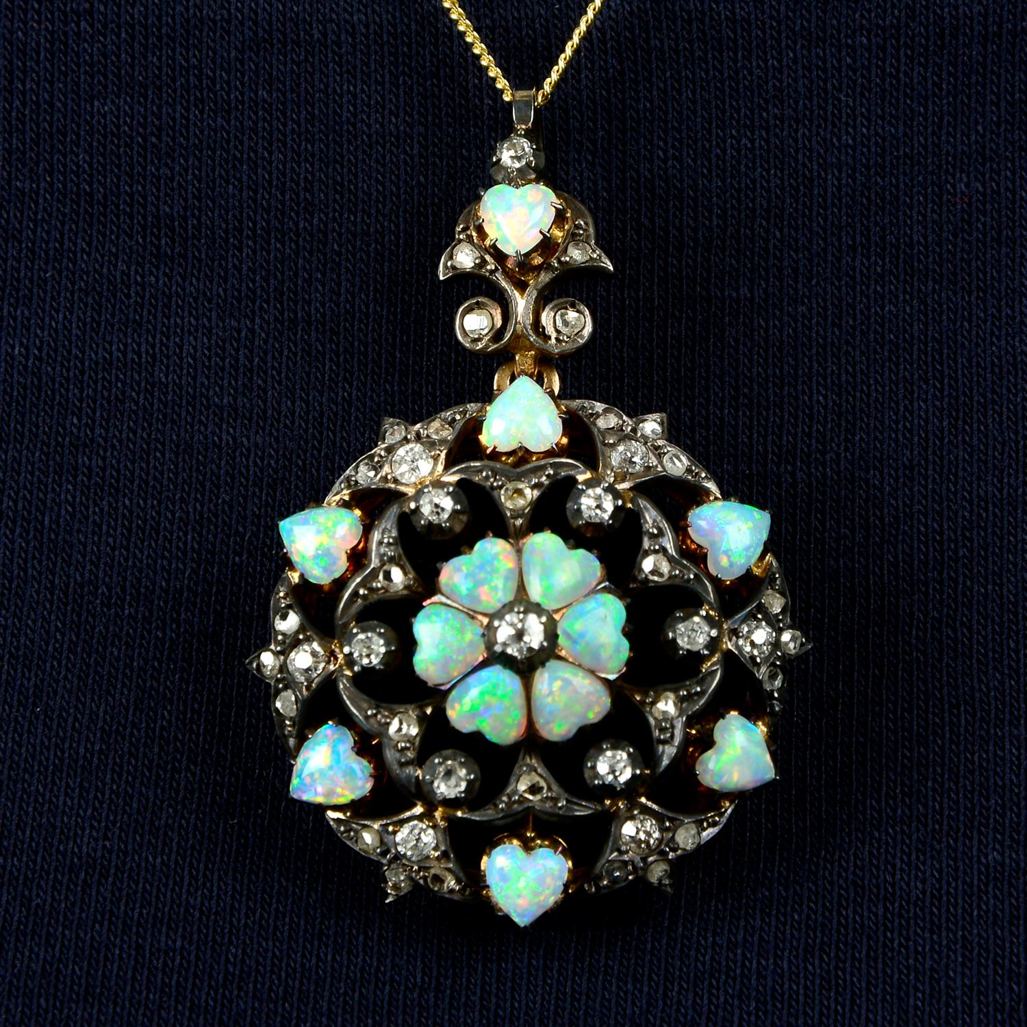 A silver and gold, late 19th century opal heart and diamond pendant/brooch.