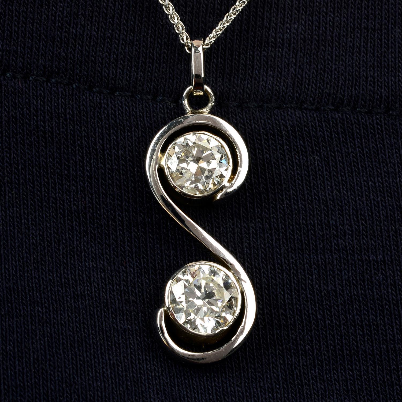 A brilliant-cut diamond two-stone pendant, with 18ct gold chain.