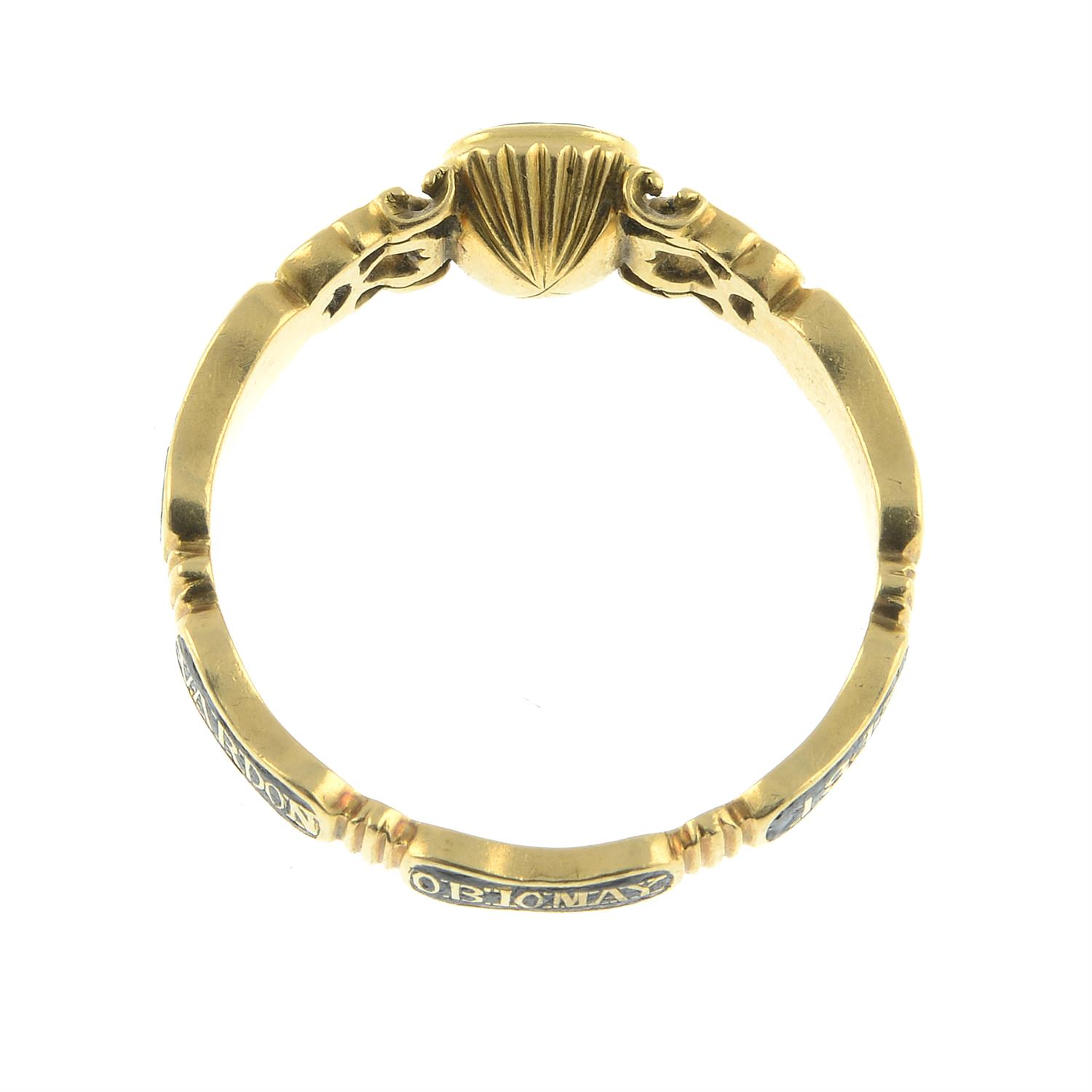 An early Victorian 18ct gold black enamel mourning ring, with pierced scrolling sides and woven - Image 6 of 7