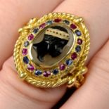 An onyx cameo, sapphire and ruby ring.