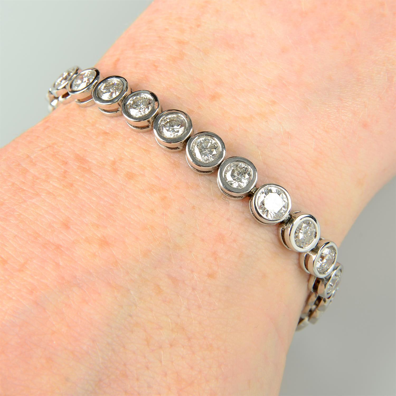 A brilliant-cut diamond line bracelet.