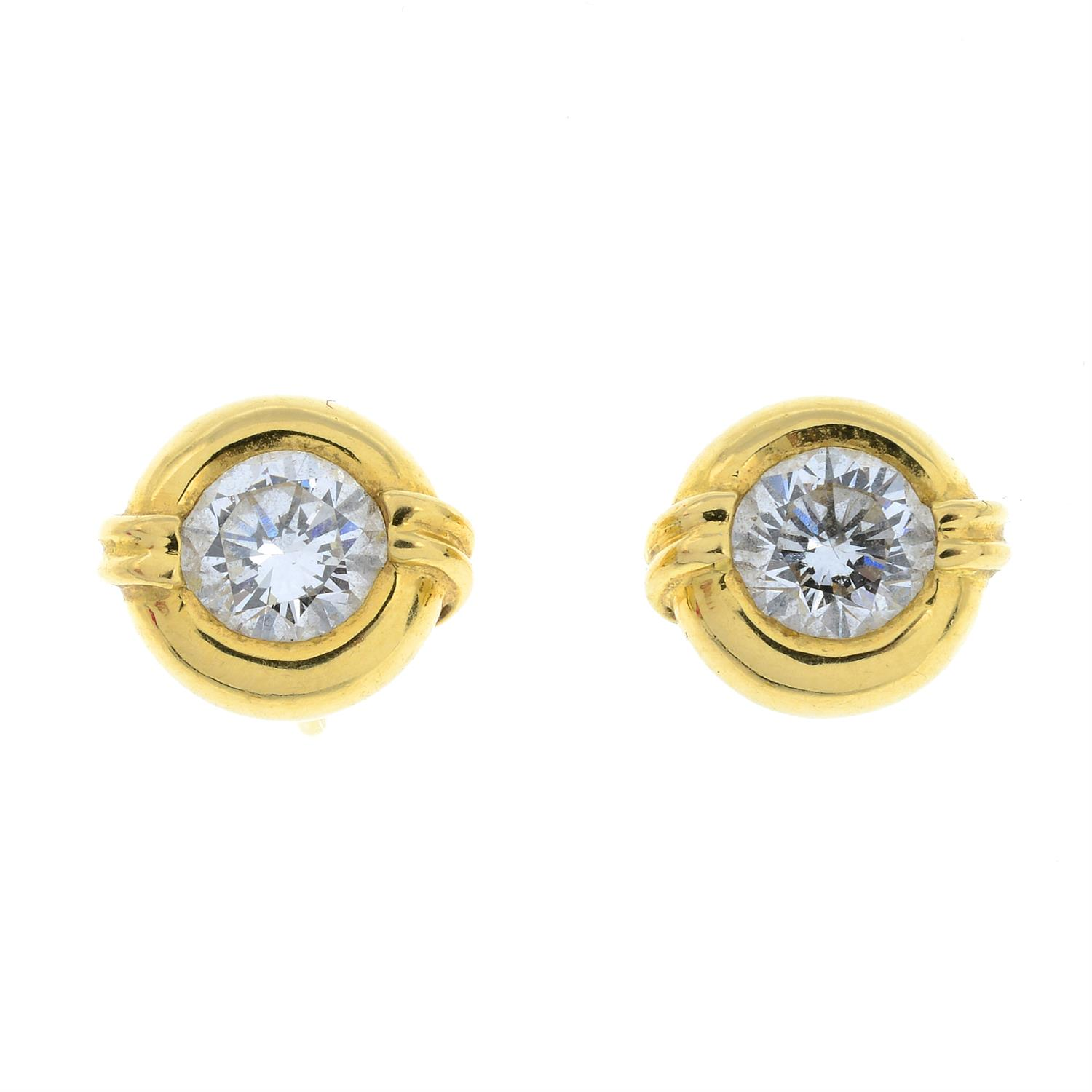 A pair of brilliant-cut diamond collet stud earrings, with raised double bar detail. - Image 2 of 4