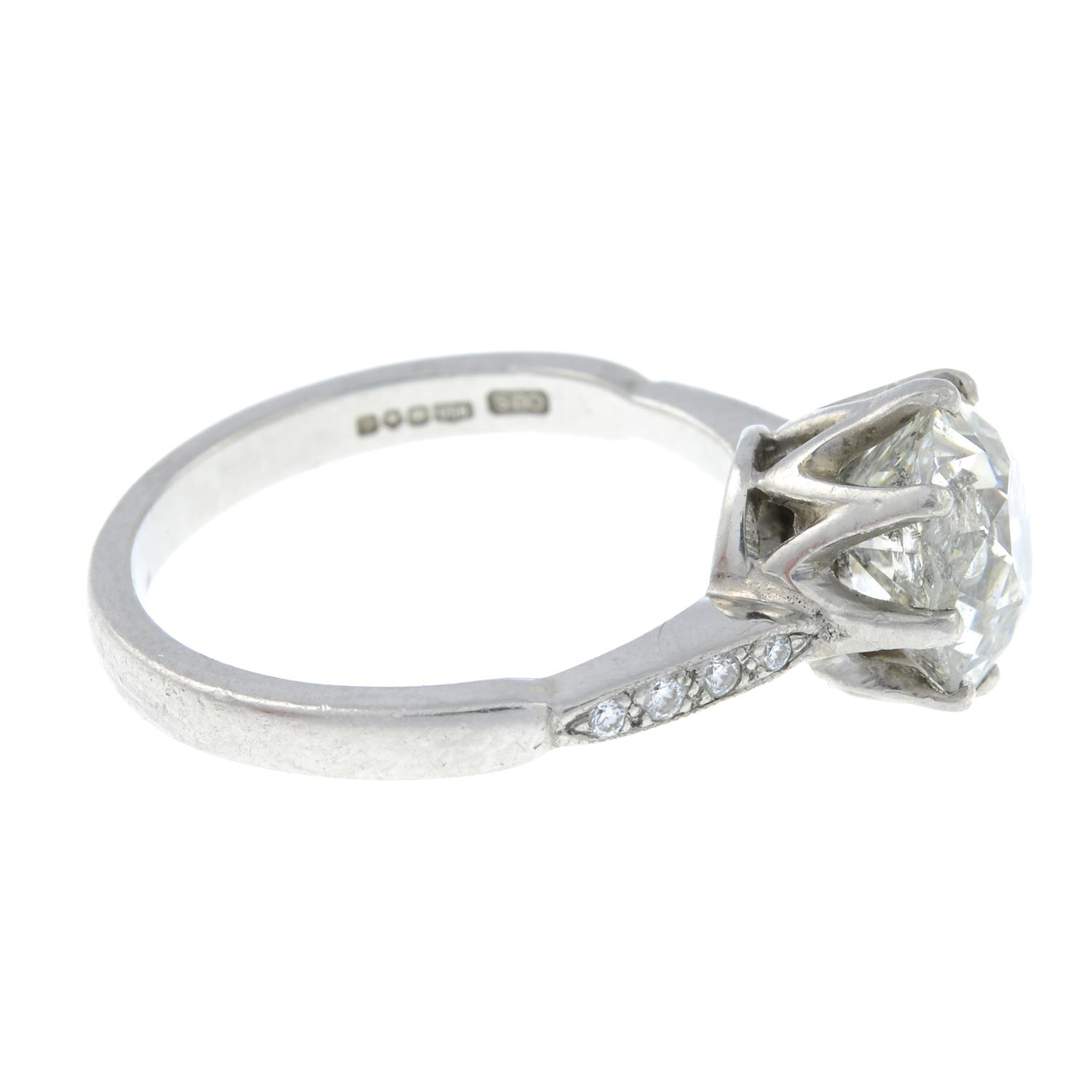 A platinum old-cut diamond single-stone ring, with brilliant-cut diamond line shoulders. - Image 4 of 6
