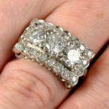 A brilliant-cut diamond three-stone ring, with single-cut diamond shared surround.