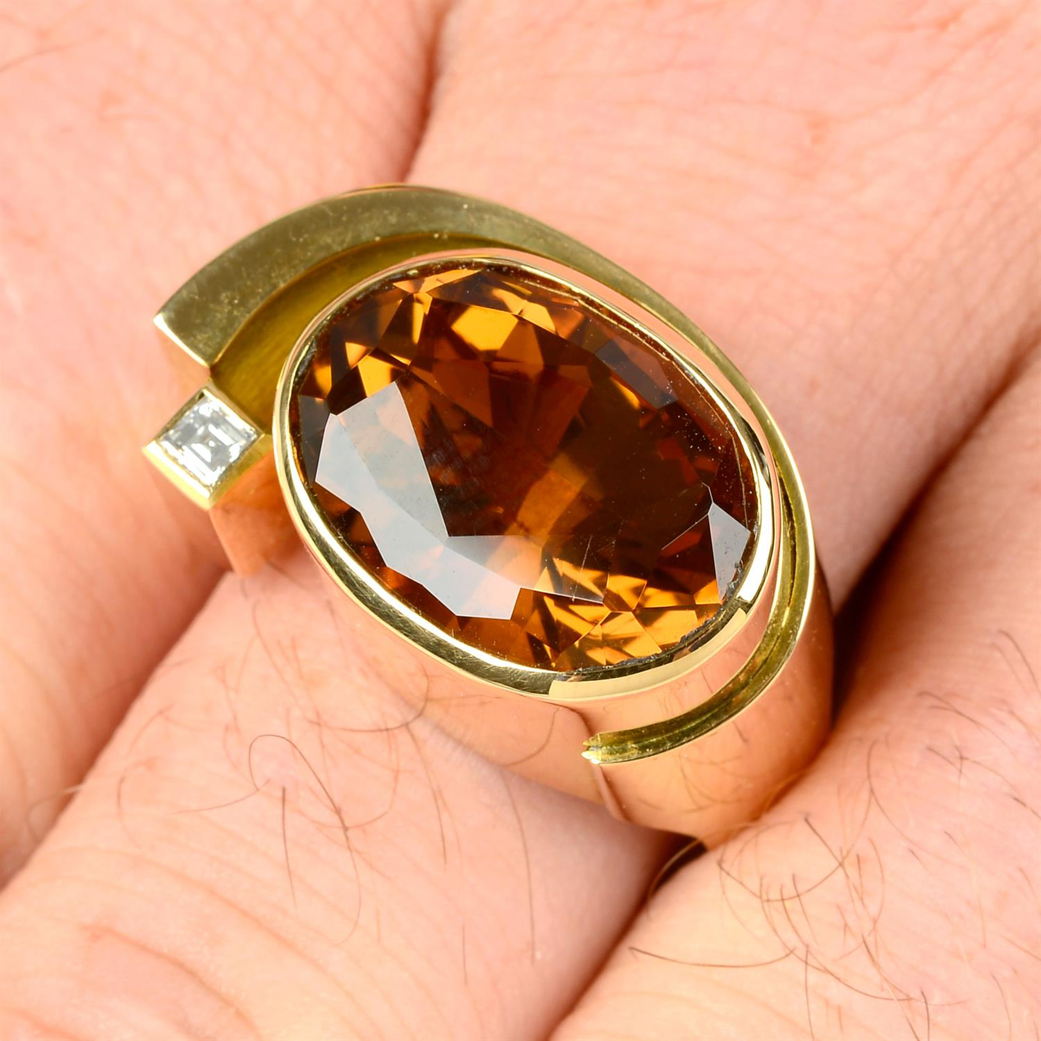 An 18ct gold citrine and square-shape diamond dress ring, by Erwin Springbrunn.