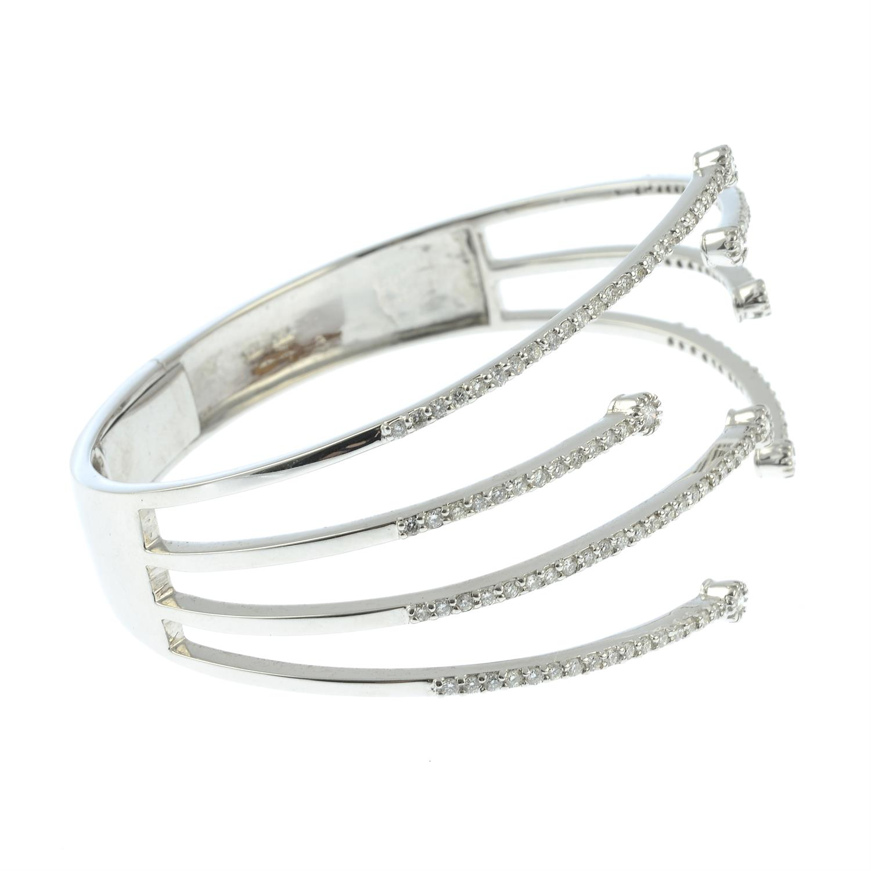 A brilliant-cut diamond open hinged bangle. - Image 5 of 5