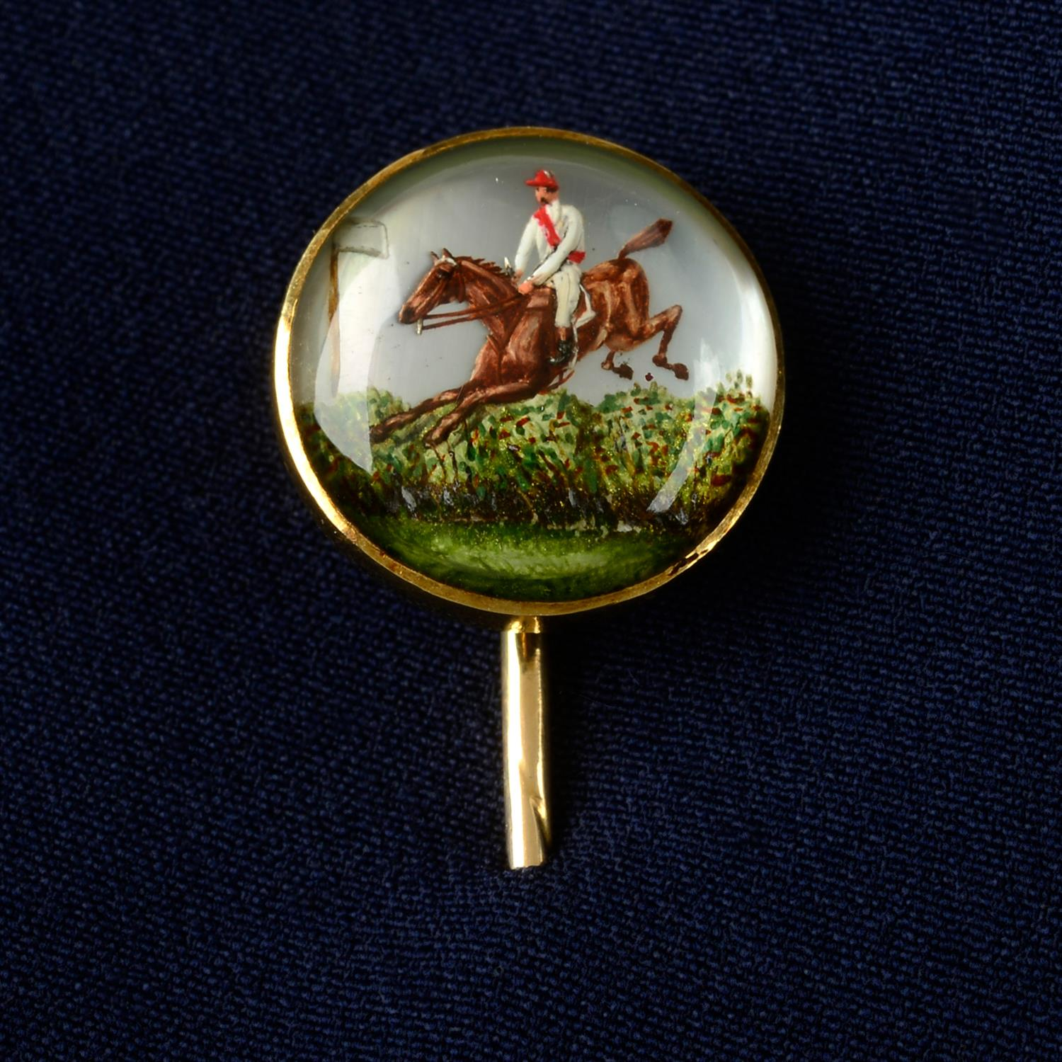 A late Victorian gold, reverse-carved and painted stickpin, depicting 1883 Grand National winner