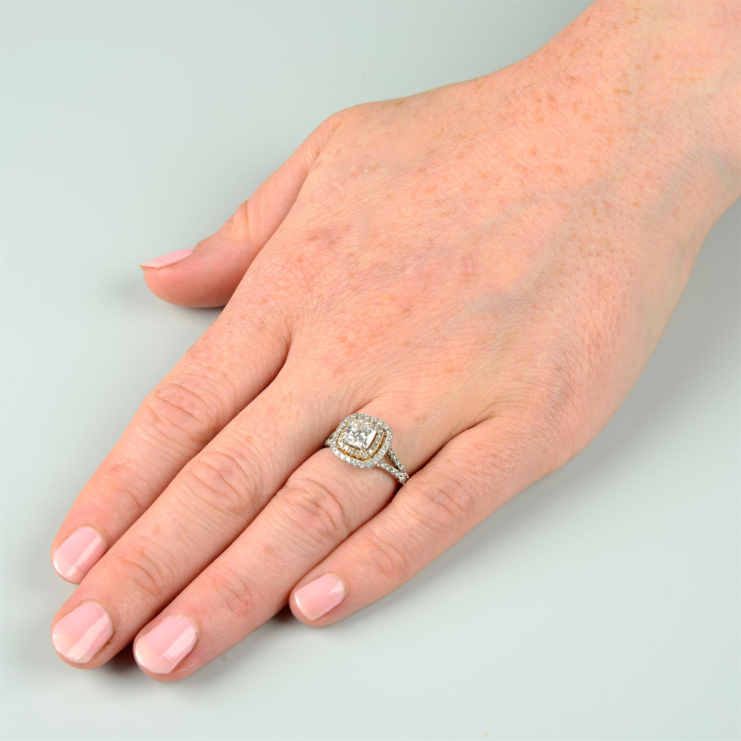 A platinum cushion-shape diamond ring, with brilliant-cut diamond surrounds and shoulders. - Image 7 of 7