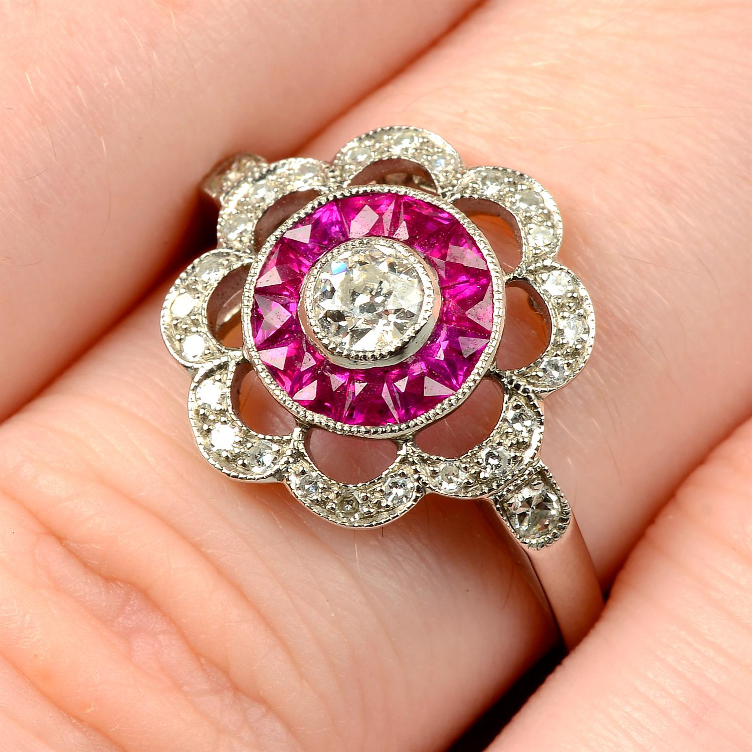 An 18ct gold diamond and French-cut ruby floral cluster ring.