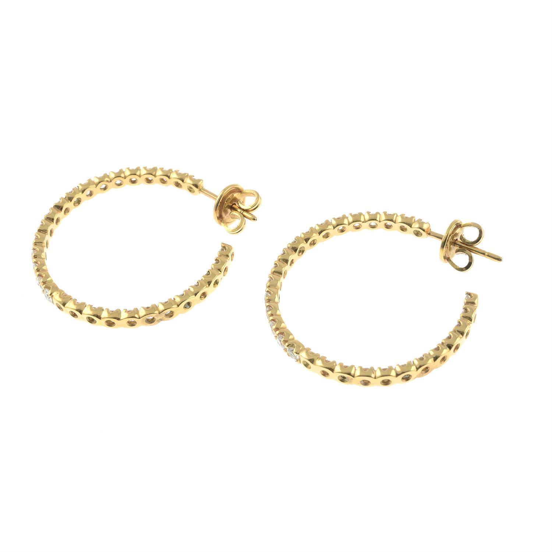 A pair of brilliant-cut diamond hoop earrings. - Image 3 of 3