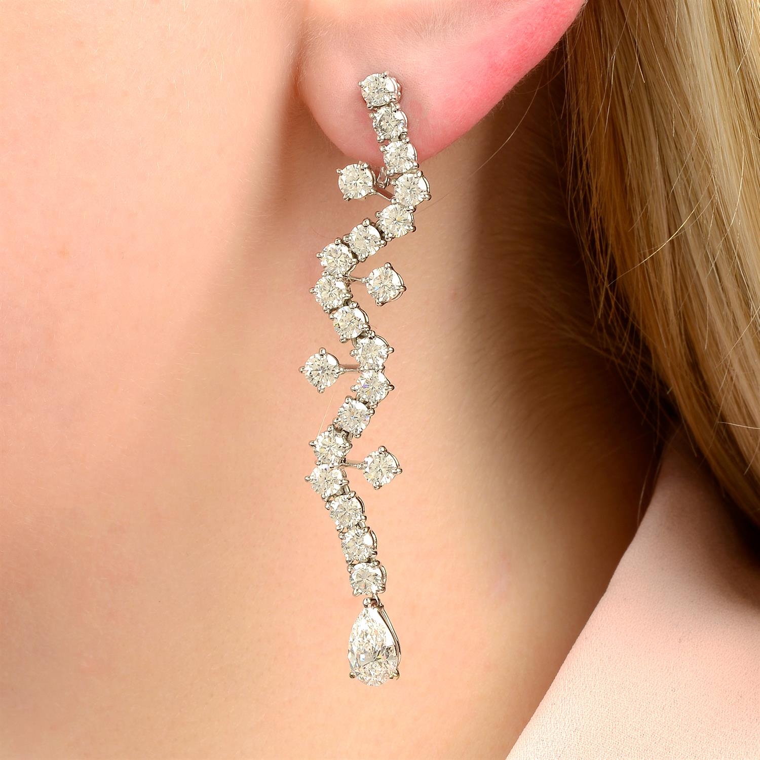 A pair of 18ct gold brilliant-cut diamond earrings, with pear-shape diamond terminals,