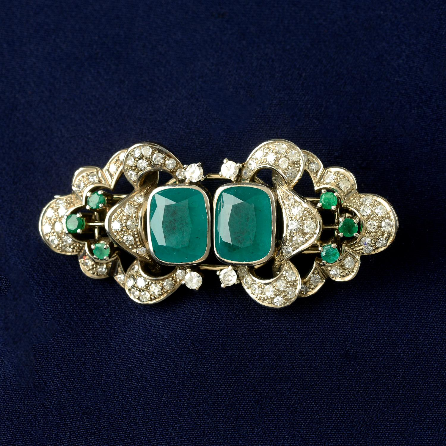 A mid 20th century 18ct gold emerald and diamond double clip brooch.