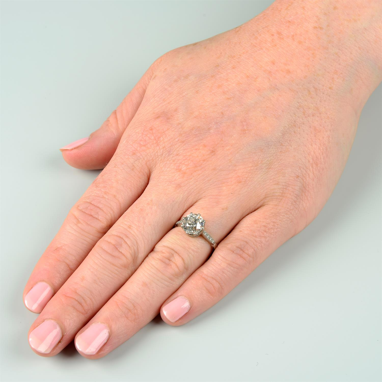 A platinum old-cut diamond single-stone ring, with brilliant-cut diamond line shoulders. - Image 6 of 6