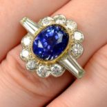 An 18ct gold Sri Lankan sapphire and diamond cluster ring.